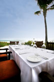 Dining on the water. A place setting for six guest at a naples Florida ocean front restaurant royalty free stock image