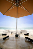Dining on the water. A place setting for four guest at a naples Florida ocean front restaurant Stock Photos