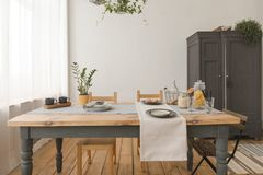 Dining wooden table in modern home Royalty Free Stock Photos