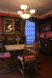 The diningroom. Country living diningroom with rich colors of blue and red makes it all warm and cosy Stock Photography