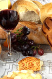 DINNER. Arrangement of bread with red wine Royalty Free Stock Photo