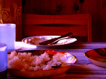 After dinner. Red/blue still life with the table after dinner Royalty Free Stock Photography