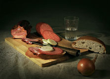 Dinner. Uportebleniem to eat meat and alkagolya Royalty Free Stock Photos