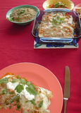 Dinner. Mexican food - enchiladas, bean dip and salsa Stock Photo