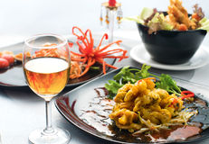 Dinner. With Thai Food : Fried Sea Mussel and Spicy Papaya Salad serve with thai wine Royalty Free Stock Image