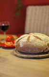 Dinner. Wine and bread on a table Stock Photos