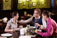 Dinner. Young people communicate during a dinner at a restaurant Royalty Free Stock Photography