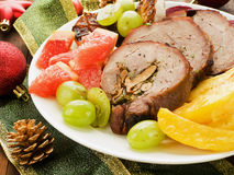 Dinner. Christmas dinner turkey roulade with fruits and vegetables. Shallow dof Stock Image