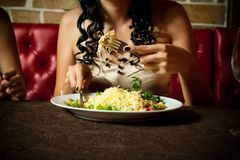 Dinner. Girl having a dinner at the restaraunt Stock Photography