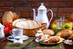 Dinner. Traditional polish dinner, fresh the bread-stuffs, hot coffe, the dairy produce Royalty Free Stock Image
