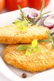 Dinner. Tasty fried chicken with herbs royalty free stock images