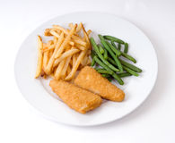 Dinner. A plate of dinner consisting of fish, french fries, and beans Stock Photo