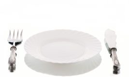 Dinner. Empty vintage  dinner setting with orcelain plate Stock Images