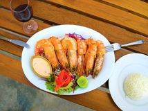 Balinese Jimbaran beach famous for it`s perfect sea food restaurants Royalty Free Stock Images