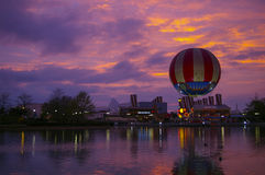Dinner Balloon and colorful sunset , Downtown Disney at Disneyland Paris France. Purple magenta pink and yellow highlight a beautiful sunset and Downtown Disney Stock Photography