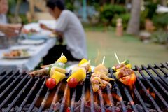 Dinner barbecue with roast seafood and pork.  royalty free stock photo