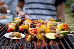 Dinner barbecue with roast seafood and pork.  stock images