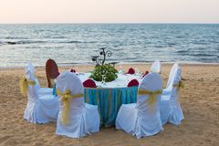 Dinner on the beach. Party table on the beach Royalty Free Stock Photo