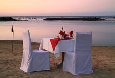 Dinner on the beach. Romantic beach dinner for two Stock Images