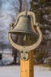 Dinner Bell. An old dinner bell shot with a shallow depth of field Stock Photos