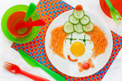 Dinner or breakfast for kids - fried egg with vegetables in the Stock Image