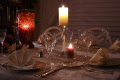 Dinner by Candlelight. A table set for a formal dinner and illuminated by candlelight royalty free stock photography
