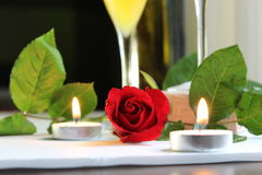 Dinner candlelight delight red rose romantic wine glass juice green leaf table top photography. Candlelight dinner table top photography Stock Photo