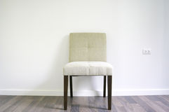 Dinner chair on the laminate floor Stock Photos
