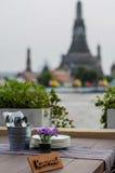 Dinner. At Chao Phraya River And Wat Arun in Bangkok - Temple of Dawn Royalty Free Stock Image