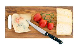 After dinner cheese on platter including blue. Isolated. Stock Image