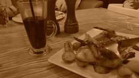 Dinner with a chiken, old style sepia view with grain stock video footage