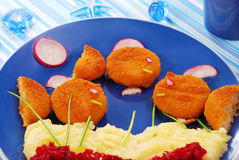 Dinner for child with fishcakes Stock Images