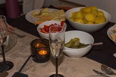 Dinner at christmas and sylvester before new years day. With champagne raclette cheese and vegetables and bread in south germany in december Royalty Free Stock Photo