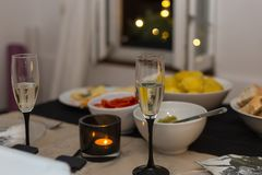 Dinner at christmas and sylvester before new years day. With champagne raclette cheese and vegetables and bread in south germany in december Stock Photos