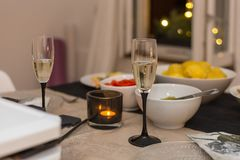 Dinner at christmas and sylvester before new years day. With champagne raclette cheese and vegetables and bread in south germany in december Stock Photography