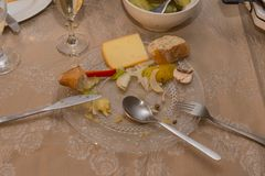 Dinner at christmas and sylvester before new years day. With champagne raclette cheese and vegetables and bread in south germany in december Royalty Free Stock Image
