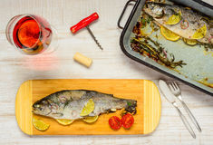 Dinner with Cooked Fish and Rose Wine Royalty Free Stock Photos