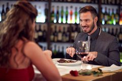 Dinner for couple in restaurant. Gala dinner for charming men and his girlfriend in restaurant Stock Image