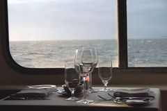 Dinner on the cruise. Window table set for dinner Stock Images