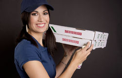 Pizza Dinner Delivered by Beautiful Female Driver Royalty Free Stock Image