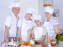 Dinner for the family. Grandparents with two boys are preparing dinner for the family royalty free stock image