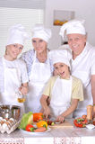 Dinner for the family. Grandparents with two boys are preparing dinner for the family Royalty Free Stock Photo