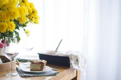 Dinner for the family. yellow flowers on the table. table near the window.  royalty free stock photography
