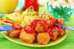 Dinner with fish nuggets Stock Images