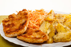 Dinner. Fried chicken roasted potatos carrot salad Royalty Free Stock Image