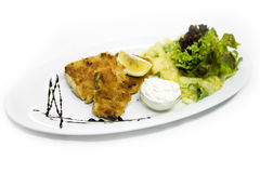 Dinner of fried fish and salad Royalty Free Stock Images