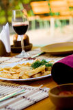 Dinner with fried potato and wine Royalty Free Stock Images