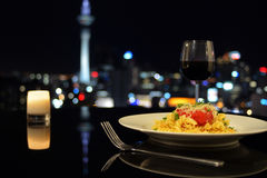 Dinner in front of Auckland city skyline at night Royalty Free Stock Photography