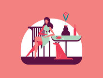 Dinner. Girl dines at the table, under which sits a dog Royalty Free Stock Images