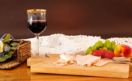 Dinner with ham, wine and fruit Royalty Free Stock Photography